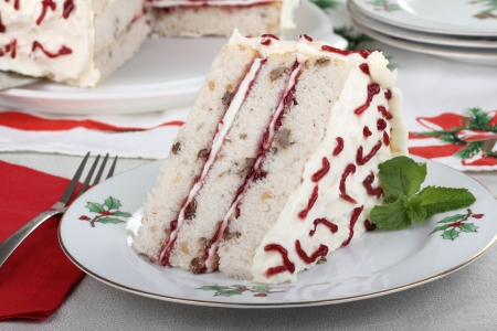Piece of white cake on a Christmas plate
