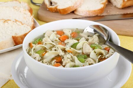 White bowl of chicken and noodle soup Stock Photo - 15894155