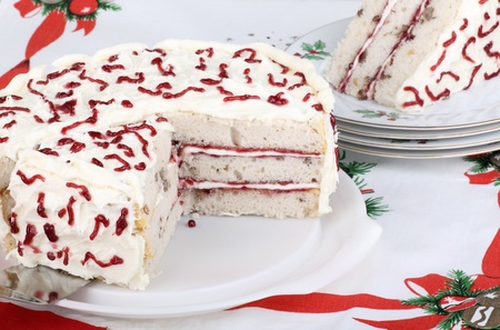 Sliced white layer cake on a platter Stock Photo - 15894152