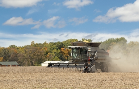 Gray combine harvesting a crop of soybeans Stock Photo - 16000143