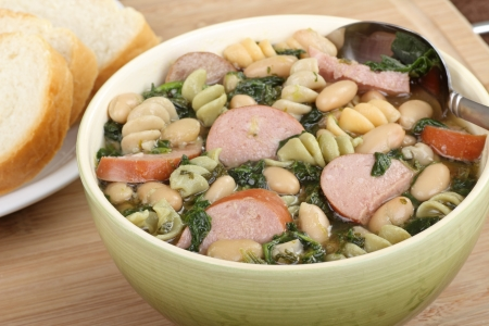 Bowl of kielbasa bean and spinach soup Stock Photo - 16000141