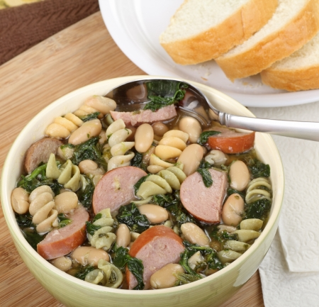 Bowl of soup with sausage, spinach, noodles and beans Stock Photo - 16000134