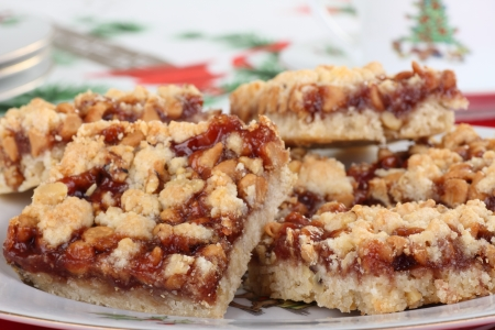 Plate of strawberry dessert bars on Christmas tablecloth Stock Photo - 16000136