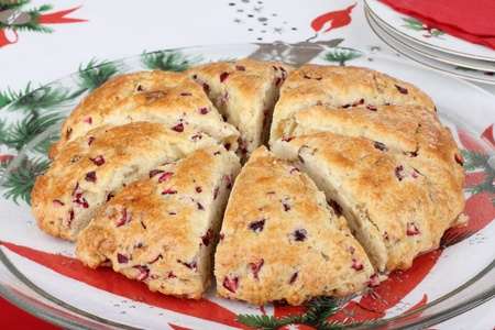 Sliced cranberry nut scone on a glass platter Stock Photo - 16000140