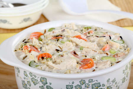 Closeup of a pot of chicken and rice soup photo
