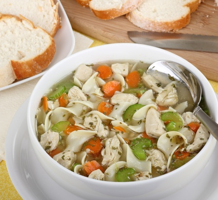 Bowl of chicken noodle soup with celery and carrots
