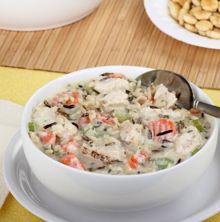 Creamy chicken soup with rice and vegetables  photo
