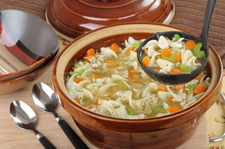Chicken and noodle soup being served in a ladle Stock Photo - 16240853
