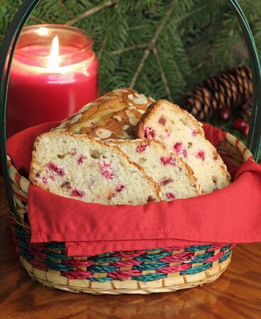 Basket of cranberry sweet bread with a burning candle in background Stock Photo - 16240856