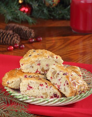 Holiday cranberry nut scones with Christmas decorations Stock Photo - 16240863