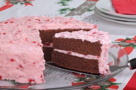 Serving a slice of chocolate layer cake with cherry frosting Stock Photo - 16240861