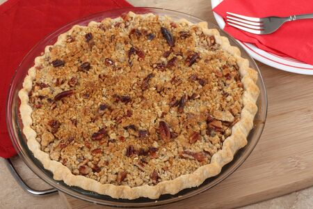 whole pecans: Top view of a pie topped with pecans Stock Photo