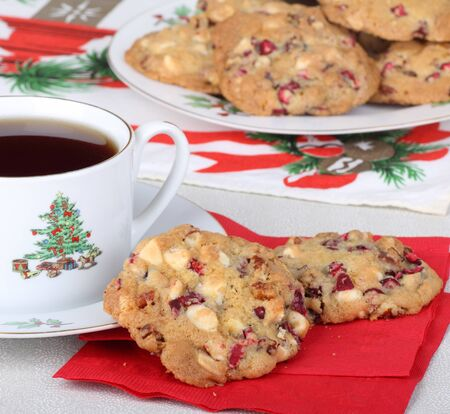 Two cranberry cookies on a napkin with cup of coffee Stock Photo - 16331951
