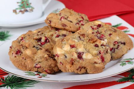 Plate of cranberry nut cookies on Christmas tablecloth photo