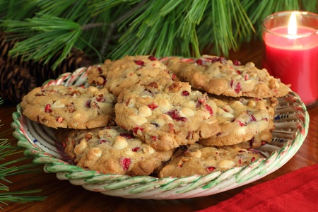 Plate of cranberry cookies lit by candle light Stock Photo - 16331957