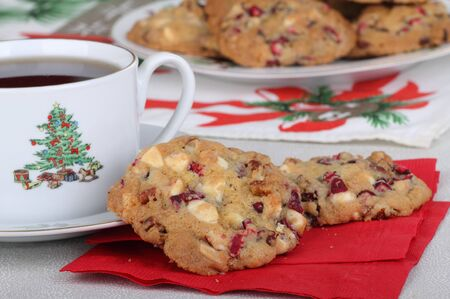 Two cranberry and nut cookies on a napkin with cup of coffee Stock Photo - 16426688