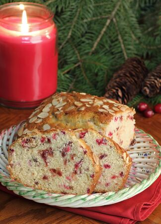 Sliced cranberry bread on a plate with candle burning in background Stock Photo - 16426690