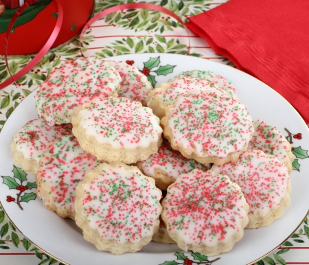 Plate of shortbread Christmas cookies with icing and colored sprinkles Stock Photo - 16426697