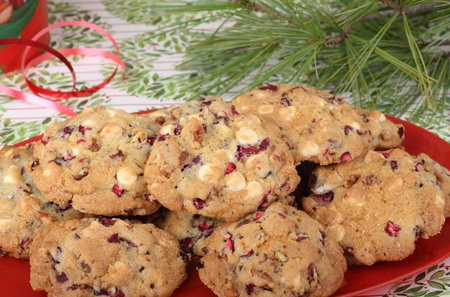 Nut and cranberry cookies on a red platter Stock Photo - 16478900