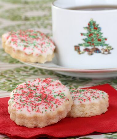 Two shortbread sugar cookies on a napkin and cup of coffee Stock Photo - 16522173