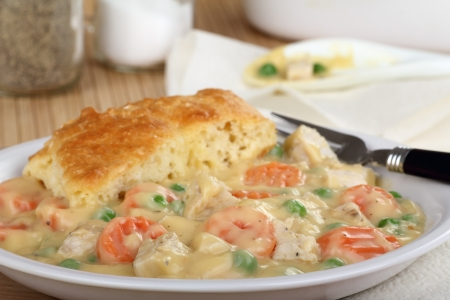 Chicken pot pie with carrots and peas Stock Photo