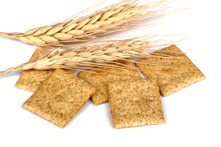 Wheat crackers and wheat heads on a white background Stock Photo - 16614627