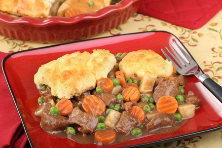 beef stew: Beef stew with carrots, peas and biscuits Stock Photo
