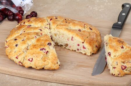 Sliced cranberry scone on a cutting board Stock Photo - 16657108