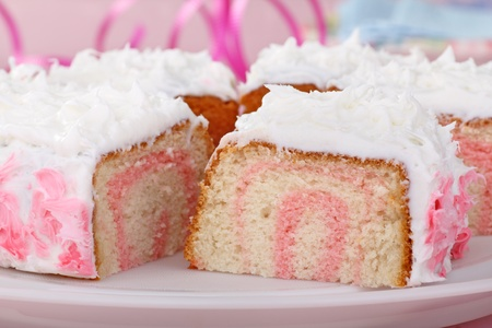 Sliced cake with white icing on a platter Stock Photo - 16687925
