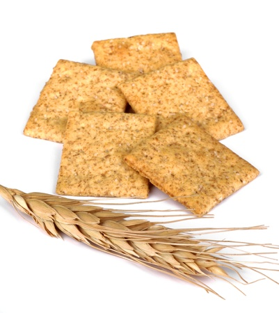 Wheat crackers and wheat head on a white background Stock Photo - 16724160