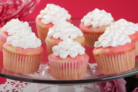 Valentine day cupcakes with white icing on a glass platter Stock Photo - 16783071