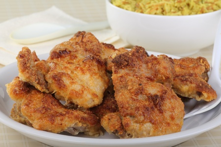 Oven baked chicken thiighs on a white platter Stock Photo - 16852675