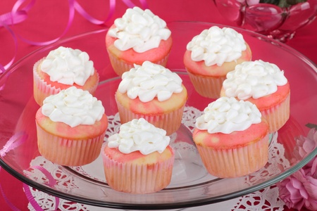 Cupcakes with white icing on a glass platter Stock Photo - 16886233