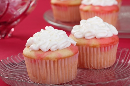 Closeup of two cupcakes with white icing Stock Photo - 16911038