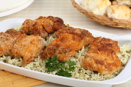 Baked chicken with rice on a serving dish Stock Photo - 16936360