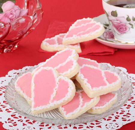 Heart shaped valentine day cookies with pink and red icing  Stock Photo - 16936357