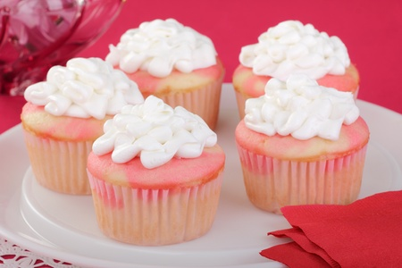 Cupcakes with white icing on a platter Stock Photo - 16936356