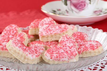Heart shaped sugar cookies with white icing and red sprinkles Stock Photo - 16972248
