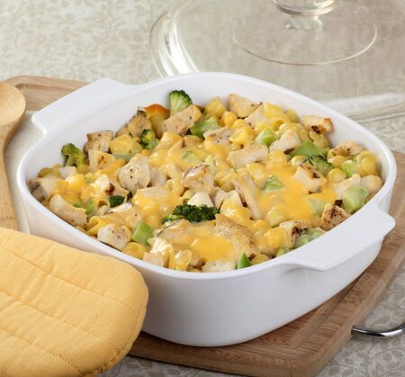 Chicken, macaroni and broccoli with melted cheese photo