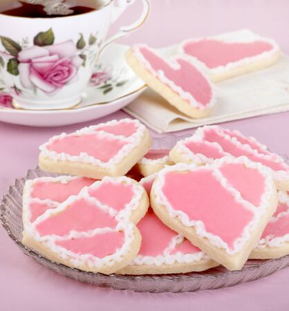 Heart shaped valentine day cookies with pink and white icing Stock Photo - 17004583