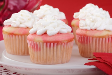 Closeup of a platter of cupcakes with white icing Stock Photo - 17004584