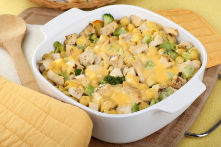 Chicken and macaroni casserole with melted cheese photo