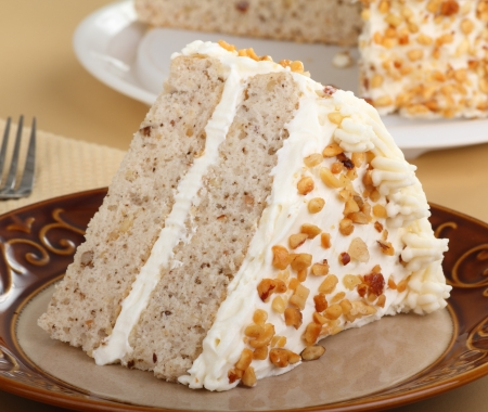 Slice of layer cake with white icing and nuts Stock Photo - 17077434