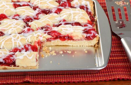 Closeup of a baking sheet of cherry bars Stock Photo - 17077438