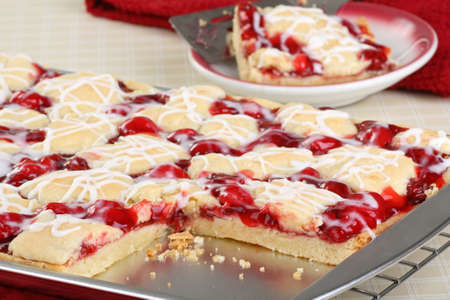 Sliced cherry bar dessert on a baking sheet Stock Photo - 17077429