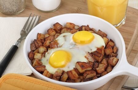 Fried potatoes with eggs cooked on top Stock Photo - 17079646