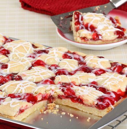 Sliced cherry bars on a baking sheet Stock Photo - 17079638
