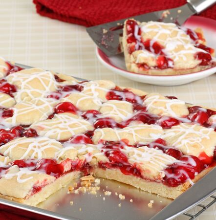 Sliced cherry bars on a baking sheet Stock Photo - 17079638