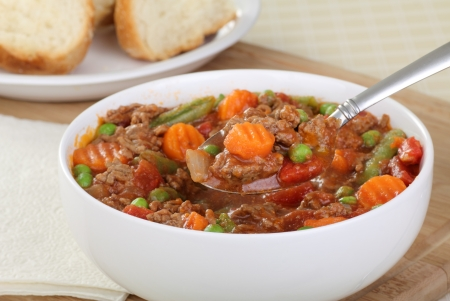 Bowl of vegetable beef soup with spoonful of soup Stock Photo - 17079639