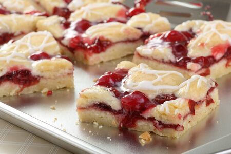 Closeup of sliced cherry bars on a baking sheet Stock Photo - 17079637